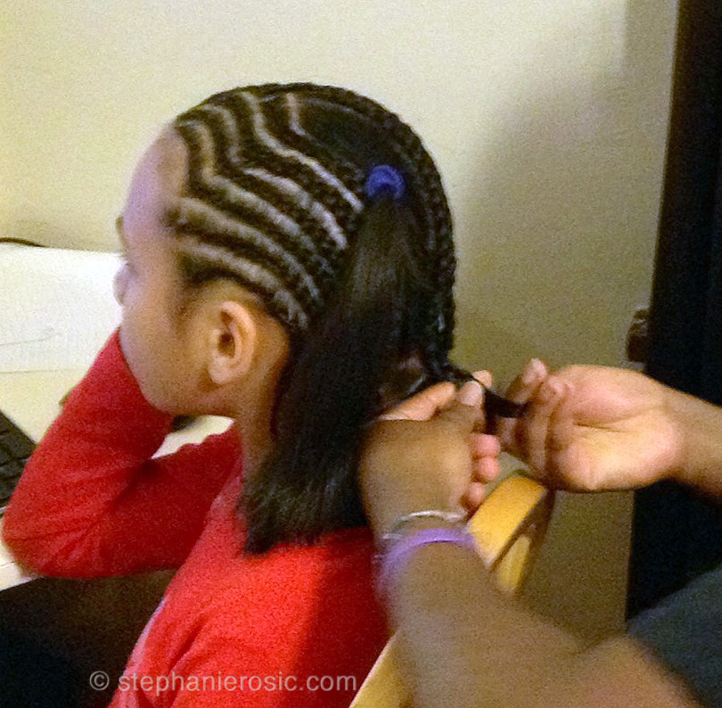 My oldest having her hair braided
